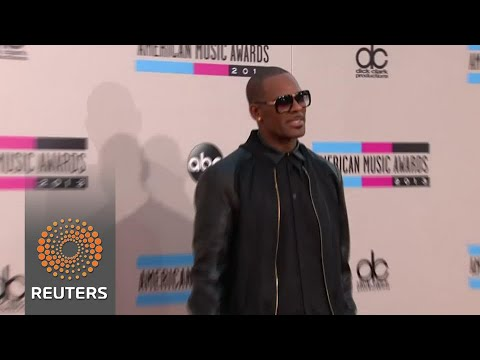 Singer R. Kelly denies cult claims