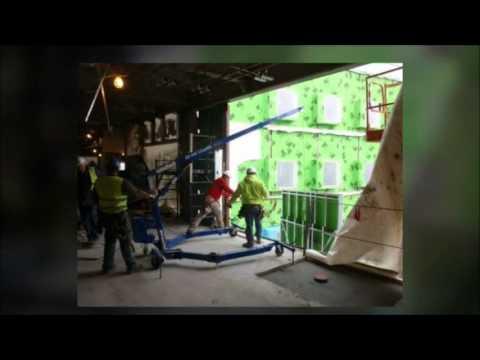 small crane lifting wall panels