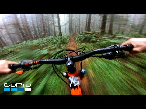 Exhilarating Downhill MTB Run Through a Foggy Forest