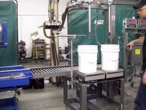 Crandall Filling Machinery, AF2/25PEI sub surface pail filler and PPC/5 pail closer PPC/5 roll trough pail closer