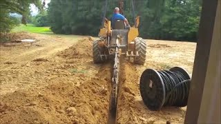 trenching & installing 525' of 4 ot tri plex electrical cable