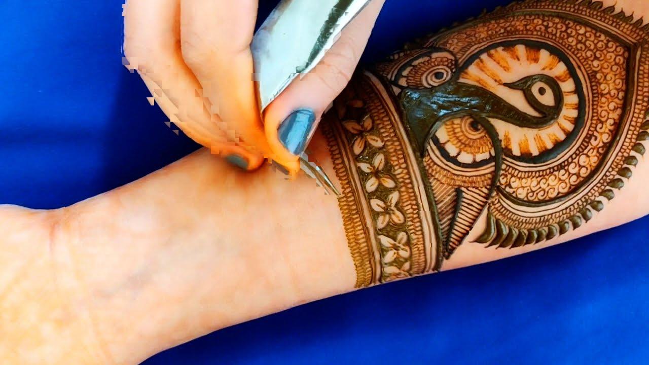 peacock mehndi design for full hand by aaru mehndi