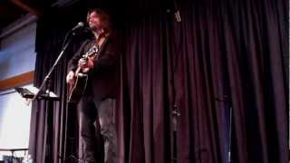 "John Flynn performs ""Two Wolves"" at the One World Coffeehouse"