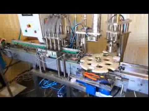 Фасовочно-упаковочная линия для розлива спокойных жидкостей в пластиковые бутылки/банки
