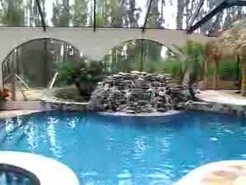 Inside Screened in Pool with Waterfall