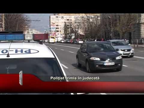 Poliţist trimis in judecată