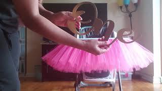 Placing the highchair tutu skirt