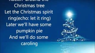 Miley Cyrus - Rockin Around The Christmas Tree (Lyrics)