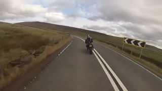 Motorcyclist Flies Off 40 ft Cliff To Avoid Head On Collision