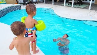 Baby Pushes Brother Into Pool!