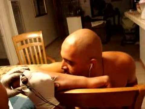 PUSSY GETTING A TATTOO. HES STILL A BITCH