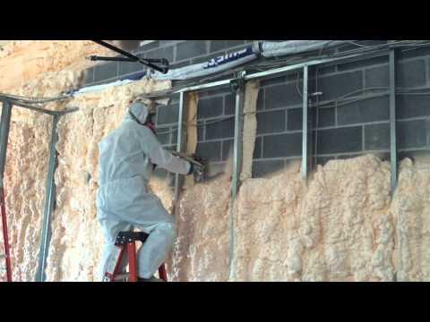 Spraying Open Cell spray foam on wall in office/shop complex being built in Aldie Va. Spray Foam both...