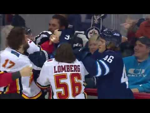 Fists, bodies flying in Jets win over Flames