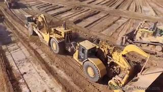 Birds eye view of an army of CAT 657E and 657G scrapers in action
