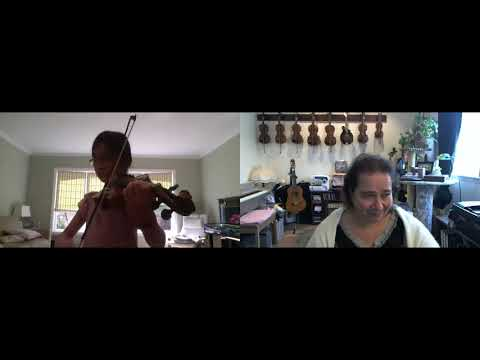 Justine, 10, is working on the book of Mazas Etudes. Zoom lessons are available for violin, viola, and piano lessons.