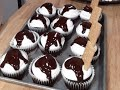 Smore's cupcake decoration: Chocolate cupcake with a graham cracker crust, topped with marshmallow fluff frosting, chocolate ganache, graham crackers, and mini marshmallows.