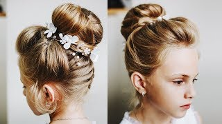 How to style little girls' thin hair.  Braid into the bun.