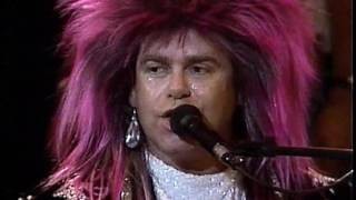 Gambar cover Elton John - I'm Still Standing (Live in Sydney with Melbourne Symphony Orchestra 1986) HD