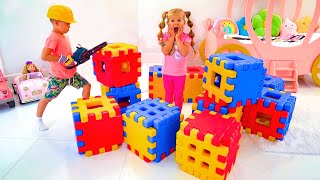 Diana and Roma Pretend Play with Toy Blocks