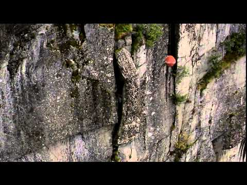 Wreckingball from helicopter used to remove unstable rock in Norway.