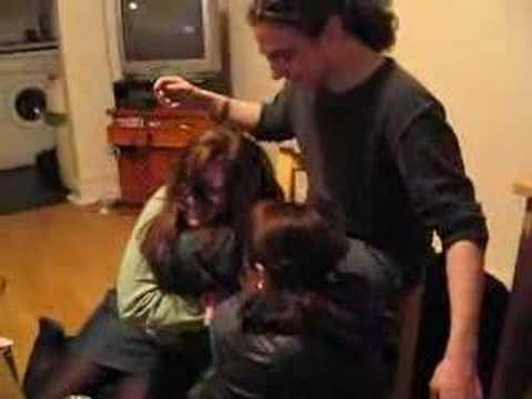 2 Crazy girls hump a guys legs