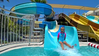 Indoor Waterpark | Child On A Water Slide In The Water Park