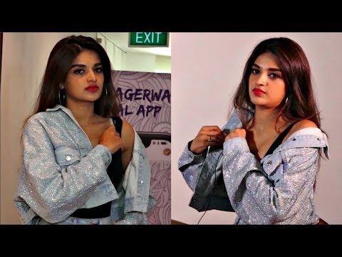 Nidhhi Agerwal CAUGHT ON CAMERA Adjusting At An Event
