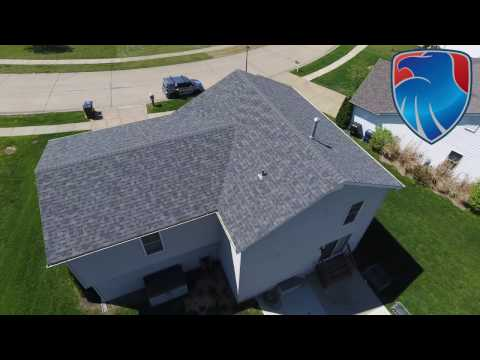 This Wentzville, MO two story home was damaged by high winds. After our inspection we advised the homeowner to make a claim. The insurance company approved the wind claim and we replaced the home owners roof with this Owens Corning Duration roof.