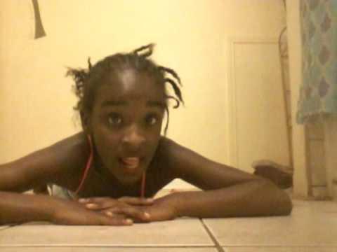 little girl doing gymnastics at home