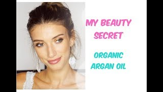 Model trying organic skincare