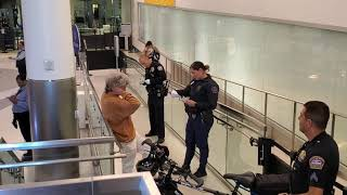 Lax airport police on 1 and tsa checkpoint  you can not record tsa