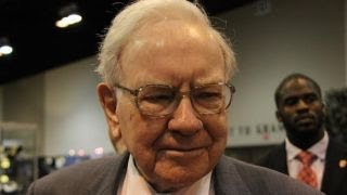 Warren Buffett on Apple investing in Tesla: It would be a poor idea