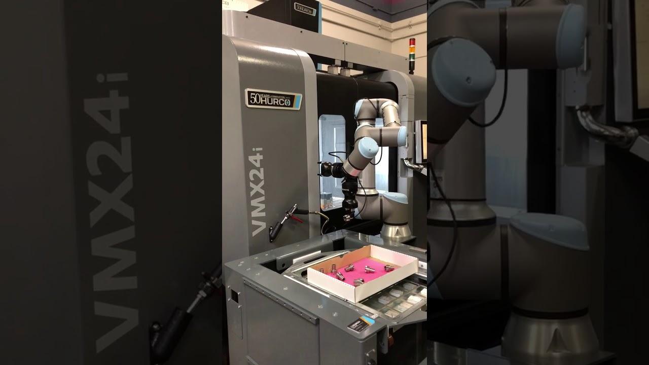 EasyRobotics, Robotic cell made easy  by Alumotion, EasyRobotics, Universal Robots and Robotiq