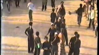مازيكا من ارشيف الحسينية / يوم عاشر محرم 1408 / 1987 - موكب الزنجيل تحميل MP3