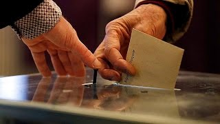 Polls open in tightly-fought French election