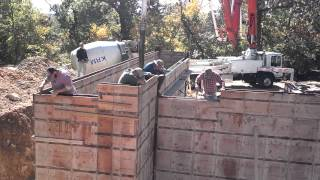 The basement walls getting poured.