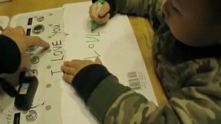 01/26/10' Sebie writing Valentine's Card to Grandpa, Grandma & Uncle Kevin