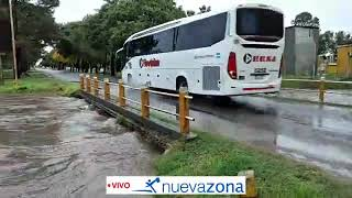 Arroyo crecido en el acceso a Viale