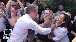 Kamala Harris bumps into Tim Ryan and his son at the Iowa State Fair