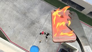 Can Flaming iPhone 6s Survive 100 FT Drop into Kiddie Pool of Water? - GizmoSlip