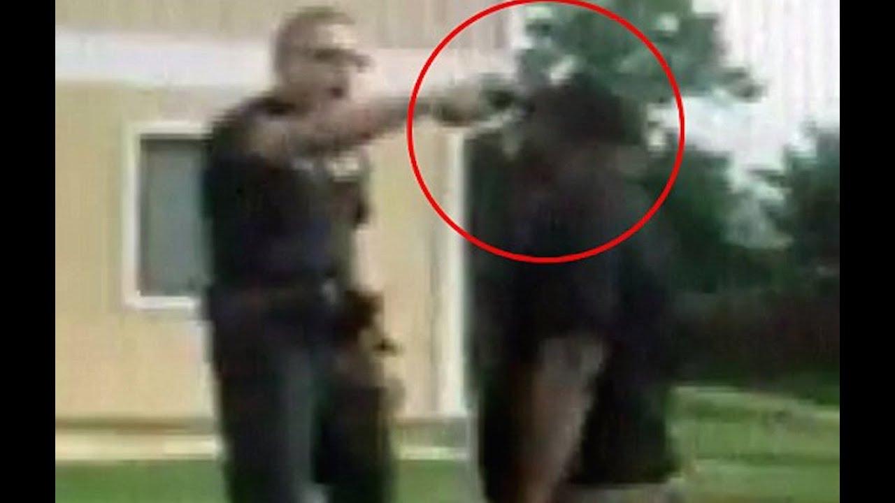Cop Points Gun At Black Man's Head thumbnail