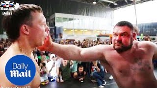 Men aggressively slap each other in Russian strength competition