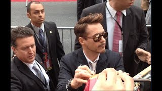 Robert Downey Jr. signs autographs for fans at the Ironman 3 Premiere