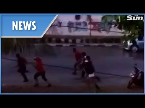 Indonesia: New Footage Of The Tsunami Crashing Into Shore