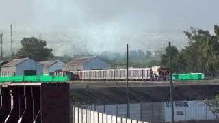 preview picture of video 'Tren del Belgrano Cargas y Logística (FCGB) saliendo de Mendoza (FCGB)'