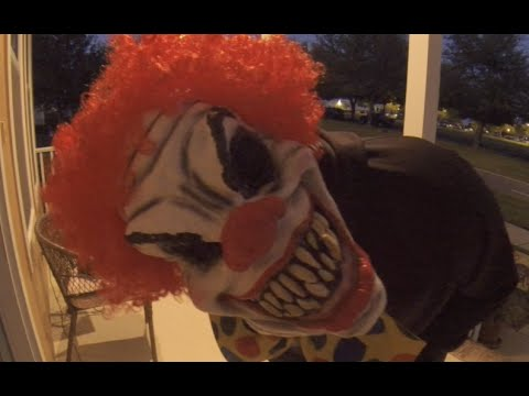 Giving out candy at Halloween as Scary Clown with a horn