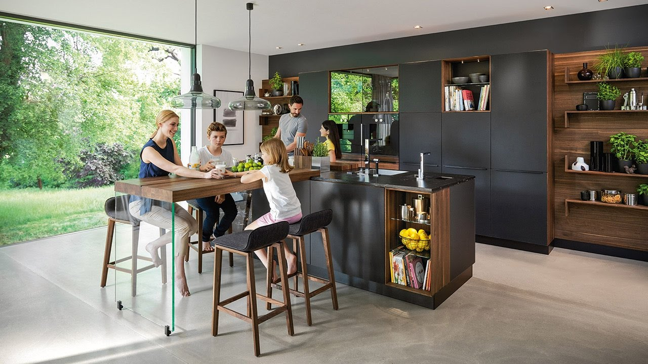 Designer kitchen black line with black coloured glass and extension table