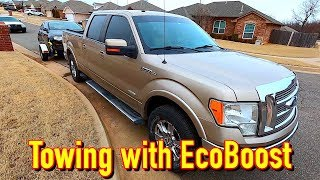 Towing the Copart VW Passat with the 220K Mile F150 EcoBoost + AAR HQ House Update!