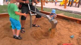 Bagr na písek - baby playing with a digger in the sand
