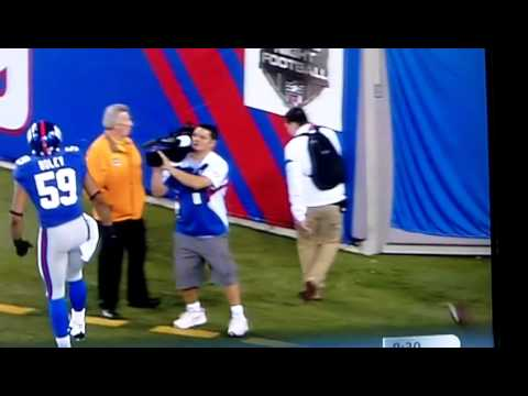 Michael Boley smashes guys face with the ball after celebrating a touchdown... Too much testosterone?